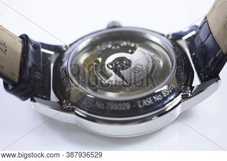 Geneve, Switzerland 01.10.2020 - Claude Bernard Swiss Made Mechanical Watch Back Case Leather Strap