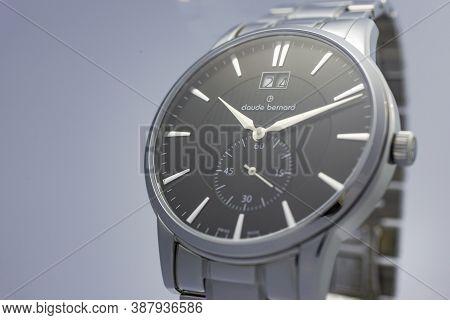 Geneve, Switzerland 01.10.2020 - Claude Bernard Man Swiss Made Watch Black Dial Date Indication 24 S