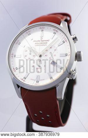 Geneve, Switzerland 01.10.2020 - Claude Bernard Man Swiss Made Watch White Dial Isolated. Date Indic
