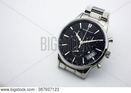 Geneve, Switzerland 01.10.2020 - Claude Bernard Man Swiss Made Watch Black Dial Isolated. Date Indic