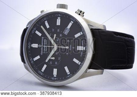 Geneve, Switzerland 01.10.2020 - Claude Bernard Man Swiss Made Watch Black Dial Leather Strap Aquari