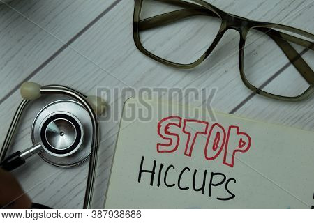 Stop Hiccups Write On A Book Isolated On Office Desk. Healthcare Or Medical Concept