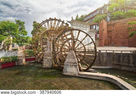 Water Wheel Is A Symbol Of Lijiang Old Town , The World Heritage Site In 1997  , Yunnan, China.