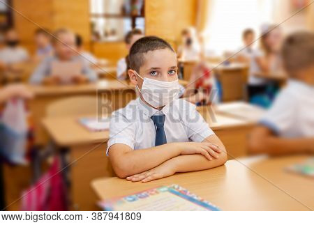 School Boy Going Back To School After Covid-19 Quarantine And Lockdown. School Child Wearing Face Ma