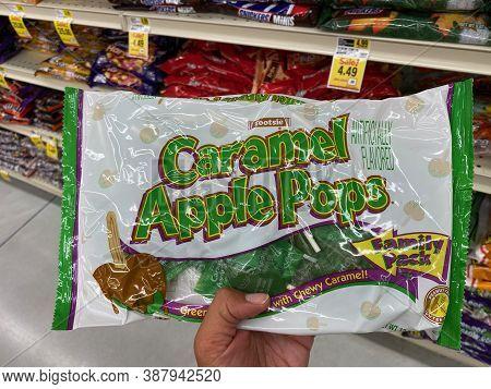 Maple Grove, Minnesota - September 14, 2020: Hand Holds Up A Bag Of Caramel Apple Pops Suckers, Pack