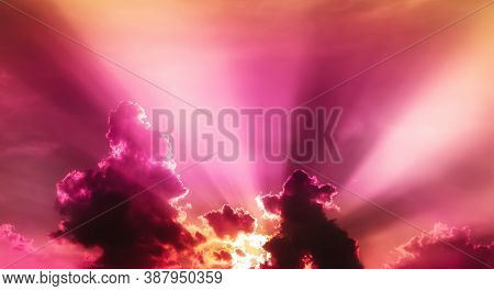 Red Violet And Orange Sunset Light In Overcast Sky With Fluffy Cloudy