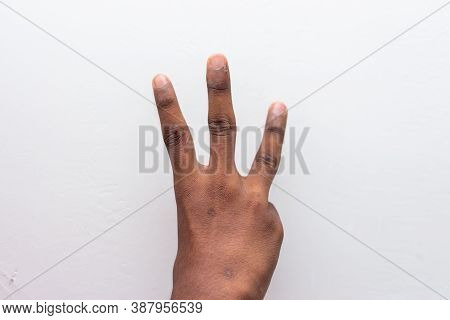 Boy Hand Showing Number Three Gesture Symbol Isolated On White Background. Gesturing Number 3. Numbe