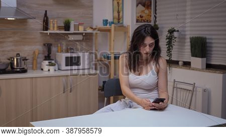 Jealous Wife Searching In Husband Smartphone. Desperate Woman Cheated, Angry, Frustrated And Irritat
