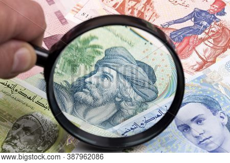 Tunisian Dinar In A Magnifying Glass A Business Background