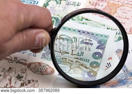 Algerian Dinar In A Magnifying Glass A Business Background