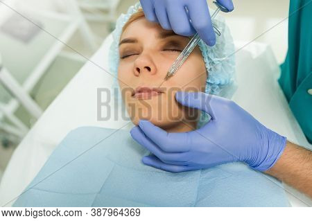 Lateral View Of Lips Augmentation Procedure On A Young Woman Done By A Cosmetologist Doctor With Hya