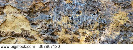Sandstone Panoramic Background. Close-up Of Holey Natural Sandstone Rocks