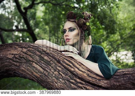 Beautiful Woman With Perfect Creative Hairstyle In Forest. Halloween Character Or Forest Soul