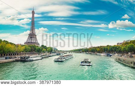 Seine In Paris With The Eiffel Tower By Day