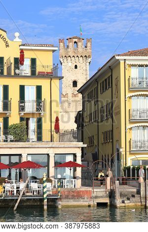 Sirmione, Italy - October 8:  The View Through Buildings On The Sirmione Waterfront To Scaligero Cas