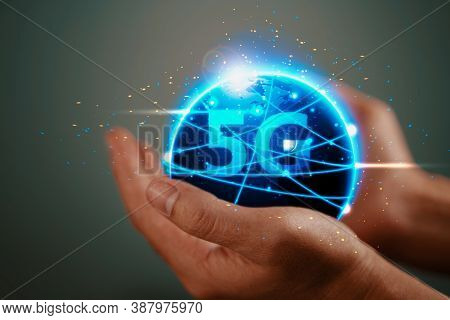 The Abstract Image Of Business Man Hold The 5g Hologram And Internet Of Things On Hand