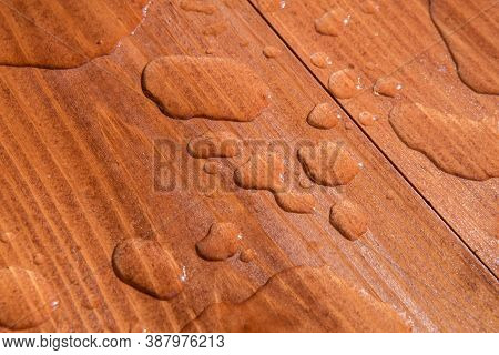 Water Drops On Wooden Board Closeup Photo