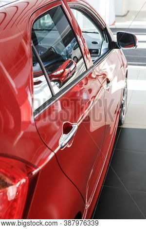 Red Beautiful Car In Interior Close-up Photo