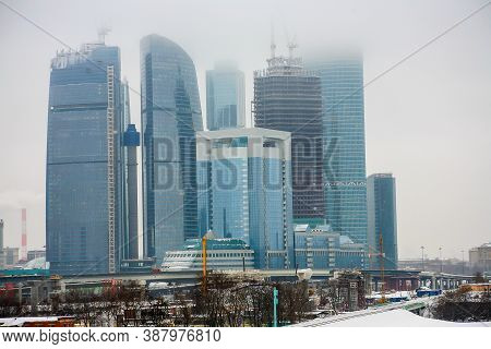 Skyscrapers Complex Of Moscow - City In The Fog In Winter