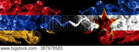 Armenia Vs Yugoslavia Smoky Mystic Flags Placed Side By Side. Thick Colored Silky Abstract Smoke Fla