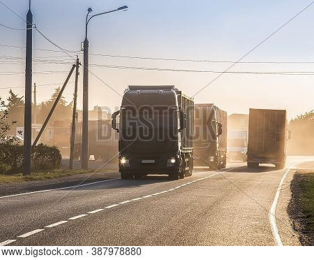 Trucks Moves On The Country Highway Photo
