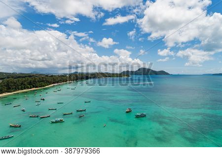 Aerial View Drone Shot Of Thai Traditional Longtail Fishing Boats In The Tropical Sea Beautiful Beac
