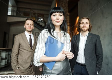 Three Office Workers Are Standing Together And Looking At The Camera. Employer Advertisement Concept