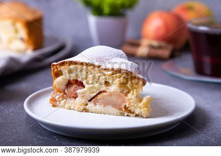 Apple Pie Charlotte Sprinkled With Powdered Sugar. A Traditional Biscuit Cake With Apples And Cinnam