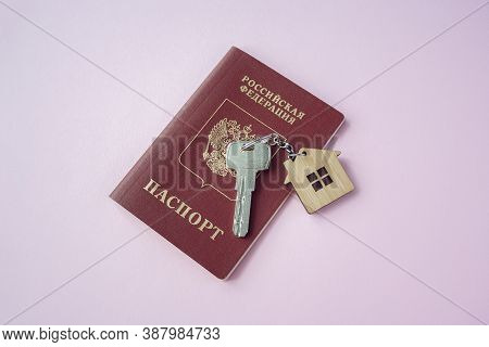 Russian International Passport And Key With Trinket House On It On Pink Background Close Up Copy Spa