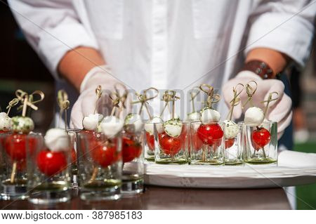 Food catering concept: Various snacks on table, outdoor banquet