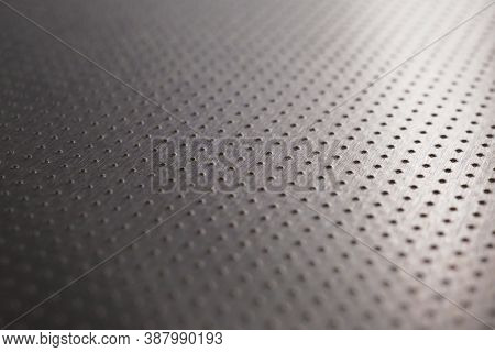 Industrial Dark Gray Metal Background Or Wallpaper. Perforated Aluminum Surface With Many Holes. The