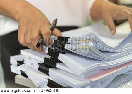 Office Workers Arranging Stacks Of Lot Documents Report Papers With Clips Waiting Be Managed On Desk