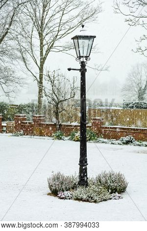 English Winter Garden Or Back Yard Covered In Snow, Uk