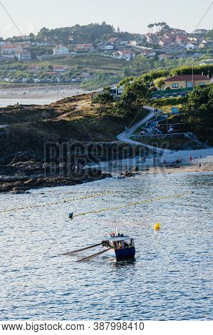 Portonovo, Spain - August 14, 2020: Fishing Boat Close To The Shore At The Rias Baixas In Galicia, S