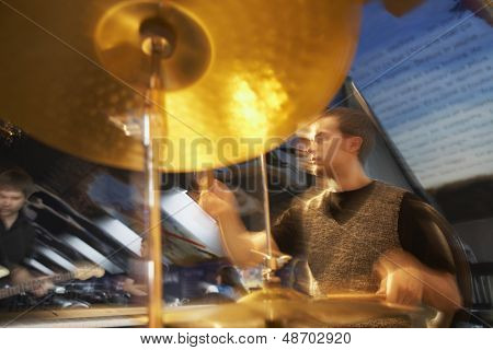 View of a male drummer in performance