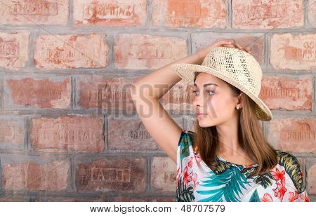 Portrait Of A Girl In A Straw Hat