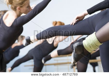 Group of ballet dancers practicing in rehearsal room