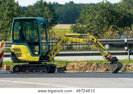 Mini Excavator On  Motorway
