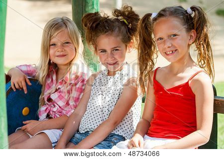Three Little Girl Friends In Park.