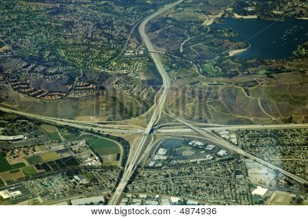 four way highway interchange in California aerial view poster