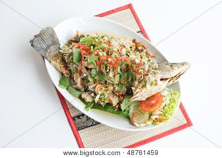 deep fried fish with spicy sauce and various herbs poster