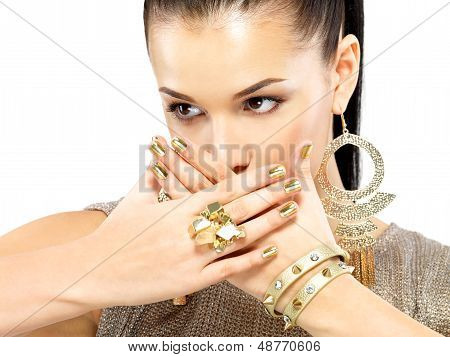 Pretty woman with golden nails and beautiful gold jewelry isolated on white background poster