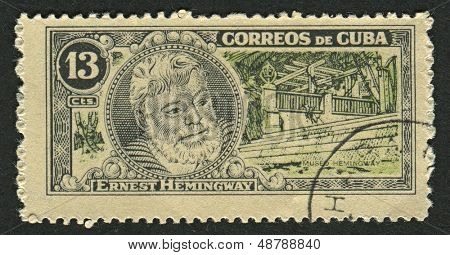CUBA - CIRCA 1963: A stamp printed in Cuba shows image of the Ernest Miller Hemingway (July 21, 1899 - July 2, 1961) was an American author and journalist, circa 1963.