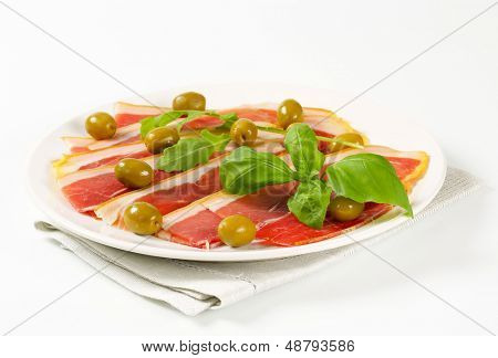 shaved parma ham with basil and olives poster