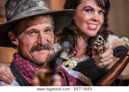 Cowboy And Saloon Girl Point Weapons