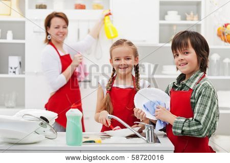 Family cleaning the kitchen and washing dishes