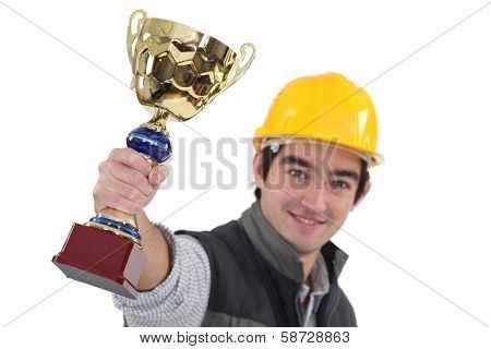 Tradesman holding up a trophy poster
