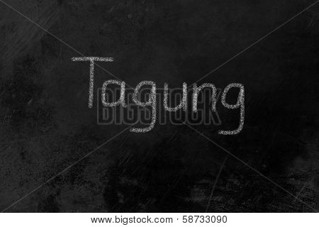 Tagung Written On A Blackboard