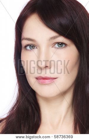 Portrait of beautiful middle-aged woman with clean make-up over white background