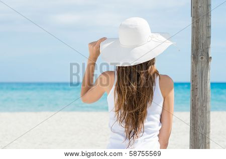 Rear View Of A Girl Wearing White Hat Looking At Sea